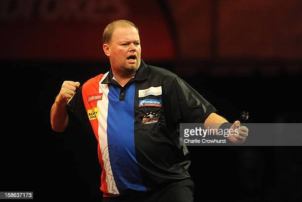 Raymond van Barneveld of the Netherlands celebrates winning a leg during his second round match against Brendan Dolan of Northern Ireland on day nine...