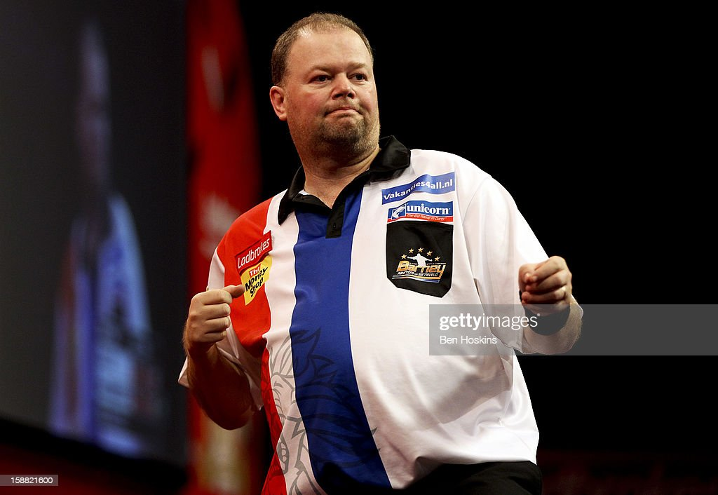 <a gi-track='captionPersonalityLinkClicked' href=/galleries/search?phrase=Raymond+van+Barneveld&family=editorial&specificpeople=2628450 ng-click='$event.stopPropagation()'>Raymond van Barneveld</a> of the Netherlands celebrates winning a set during his semi final match against Phil Taylor of England on day fourteen of the 2013 Ladbrokes.com World Darts Championship at the Alexandra Palace on December 30, 2012 in London, England.