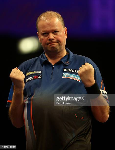 Raymond van Barneveld of the Netherlands celebrates winning a set during his quarter final match against Stephen Bunting of England on day twelve of...