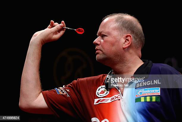 Raymond Van Barneveld of the Netherlands in action against Michael Van Gerwen of the Netherlands during the 2015 Dubai Duty Free Darts Masters...