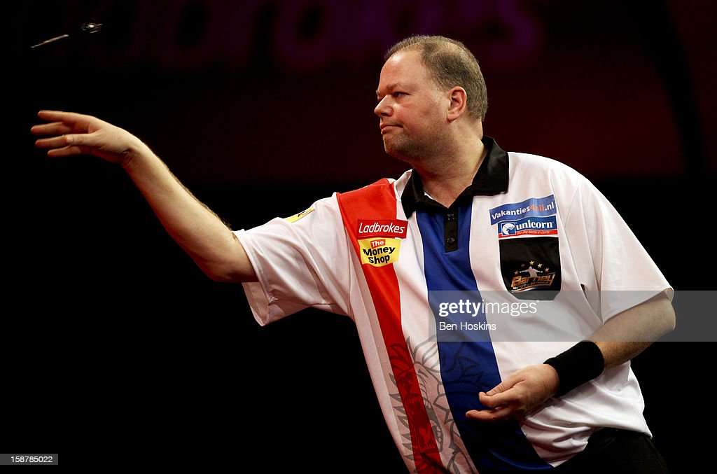 <a gi-track='captionPersonalityLinkClicked' href=/galleries/search?phrase=Raymond+van+Barneveld&family=editorial&specificpeople=2628450 ng-click='$event.stopPropagation()'>Raymond van Barneveld</a> of the Netherlands in action during his quarter final match against Simon Whitlock of Australia on day twelve of the 2013 Ladbrokes.com World Darts Championship at the Alexandra Palace on December 28, 2012 in London, England.