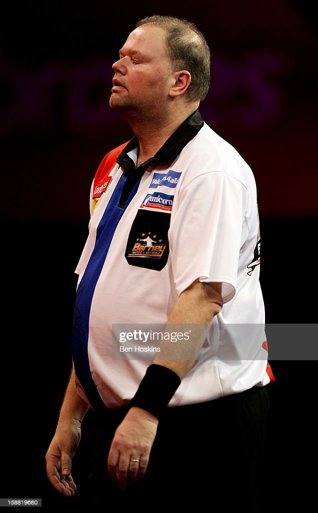 Raymond van Barneveld of the Netherlands looks dejected during his semi final match against Phil Taylor of England on day fourteen of the 2013 Ladbrokes.com World Darts Championship at the Alexandra Palace on December 30, 2012 in London, England.