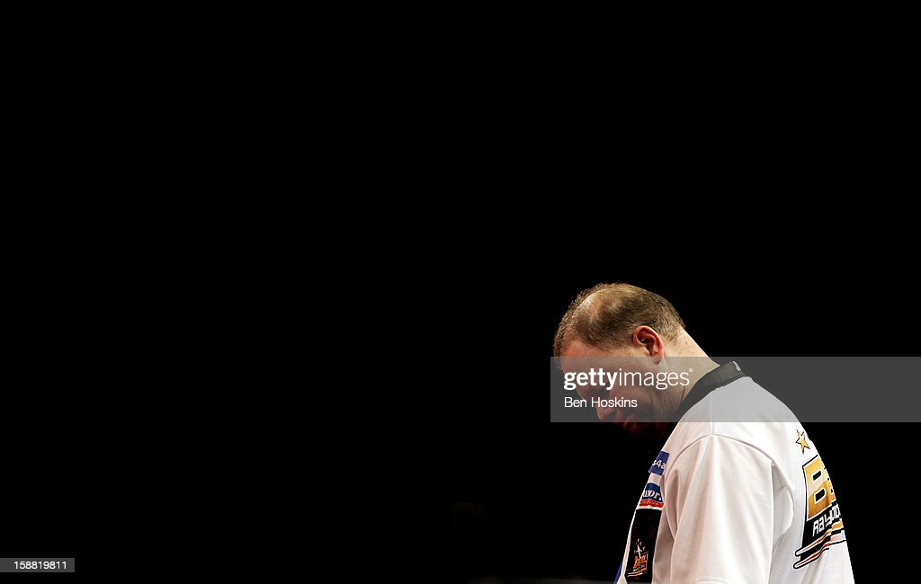 Raymond van Barneveld of the Netherlands looks on during his semi final match against Phil Taylor of England on day fourteen of the 2013 Ladbrokes.com World Darts Championship at the Alexandra Palace on December 30, 2012 in London, England.