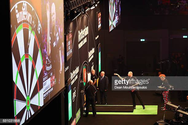 Raymond van Barneveld of the Netherlands plays a shot in his match against Peter Wright of Scotland during the Darts Betway Premier League Night 15...