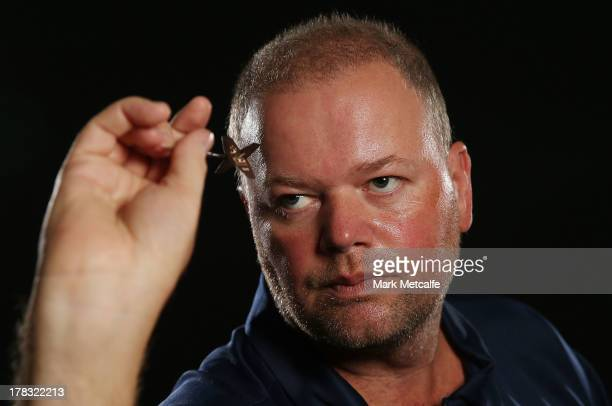 Raymond van Barneveld of the Netherlands poses for a portrait ahead of the Sydney Darts Masters at Luna Park on August 29 2013 in Sydney Australia