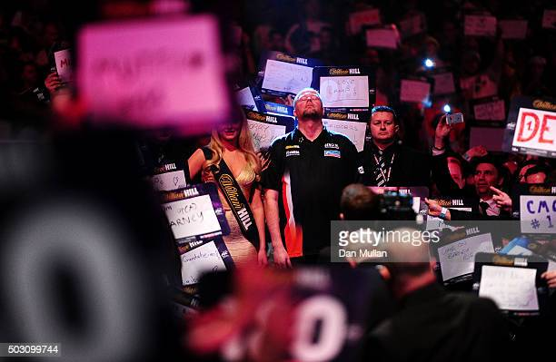 Raymond van Barneveld of the Netherlands prepares to take to the stage for his quarter final match against Michael Smith of England during Day...