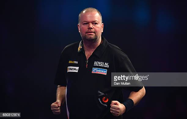 Raymond van Barneveld of the Netherlands reacts during the first round match against Robbie Green of Great Britain on day six of the 2017 William...