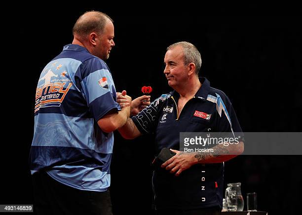 Raymond van Barneveld of the Netherlands shakes hands with Phil Taylor of England after the McCoys Premier League Darts PlayOffs Semi Final match...