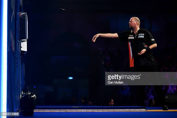 Raymond van Barneveld of the Netherlands throws a warm up dart during the first round match against Robbie Green of Great Britain on day six of the...
