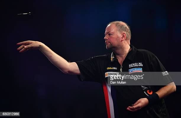 Raymond van Barneveld of the Netherlands throws during the first round match against Robbie Green of Great Britain on day six of the 2017 William...