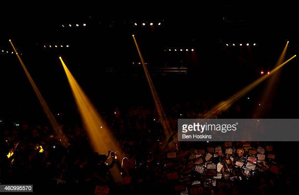 Raymond van Barneveld of the Netherlands walks on ahead of his semi final match against Phil Taylor of England on day thirteen of the 2015 William...