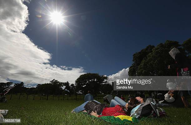 Raynne Cardoz of Brazil looks towards the sun as the moon is seen passing over the sun during a Solar Eclipse on November 14 2012 in Auckland New...