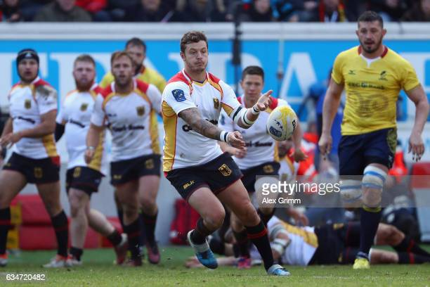 Raynor Parkinson of Germany passes the ball during the European Shield Rugby match between Germany and Romania at SpardaBankHessenStadion on February...