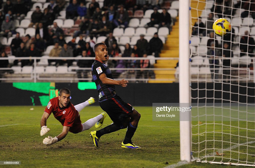 Rayo Vallecano de Madrid goalkeeper Ruben fails to save the opening goal, scored by Fran Rico #4 (not pictured) of Granada CF and watched by <a gi-track='captionPersonalityLinkClicked' href=/galleries/search?phrase=Youssef+El-Arabi&family=editorial&specificpeople=7132671 ng-click='$event.stopPropagation()'>Youssef El-Arabi</a> of Granada CF during the La Liga match between Rayo Vallecano de Madrid and Granada CF at Teresa Rivero stadium on December 14, 2013 in Madrid, Spain.