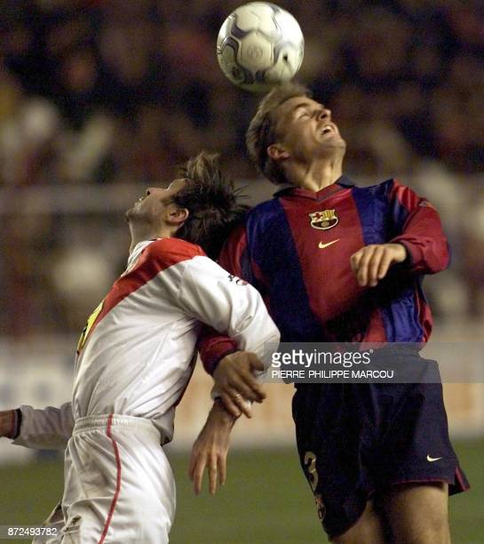 Rayo Vallecano's Bolic fights for a header with FC Barcelona's De Boer 16 December 2000 during their Primavera division match in Madrid AFP...