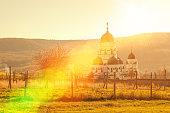 rays of sun lights over the orthodox monastery Capriana , from Moldova