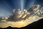 Rays of sunlight through the clouds.