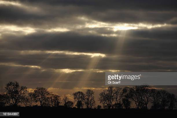 Rays of sunshine break through cloud cover over rural Lincolnshire on February 14 2013 in Coningsby England