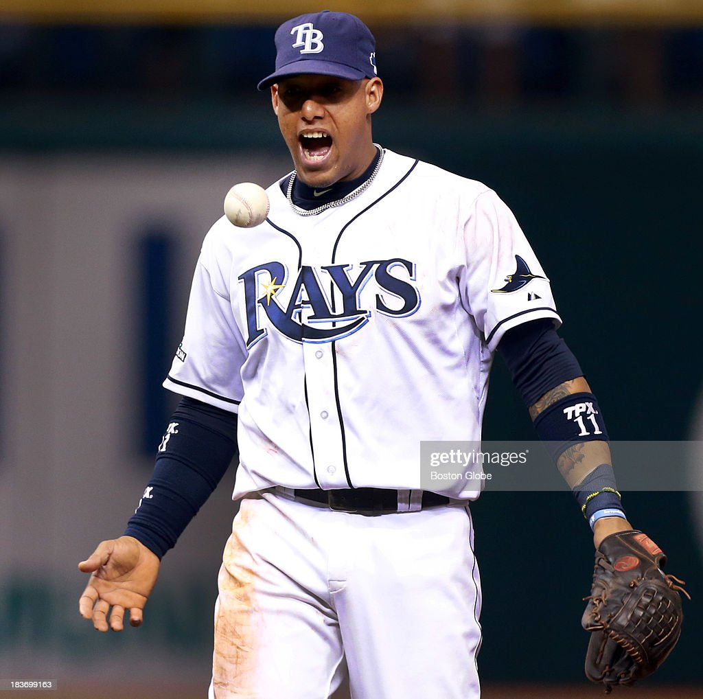 Rays shortstop Yunel Escobar tosses the ball and howls in delight after the double play that ended the top of the fourth inning. The Boston Red Sox visited the Tampa Bay Rays in Game Four of the ALDS baseball playoffs at Tropicana Field.