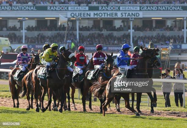 Raz De Maree ridden by Ger Fox breaks the start tape for a false start in the 2017 Randox Health Grand National at Aintree Racecourse on April 8 2017...
