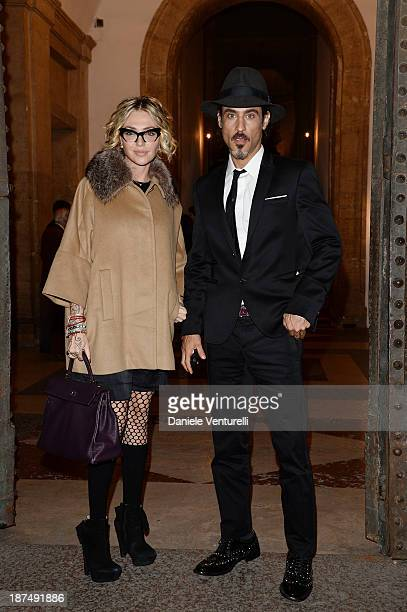 Raz Degan and Paola Barale attend the Vanity Fair Dinner during The 8th Rome Film Festival at Villa Medici on November 9 2013 in Rome Italy