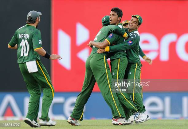 Raza Hasan of Pakistan is congratulated by teammates Mohammad Hafeez Shahid Afridi after getting Shane Watson of Australia LBW during the ICC World...