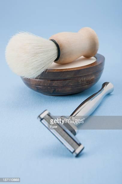 Razor and shaving cream and brush