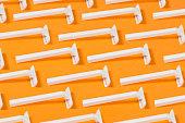 Razor Blades On Orange Background