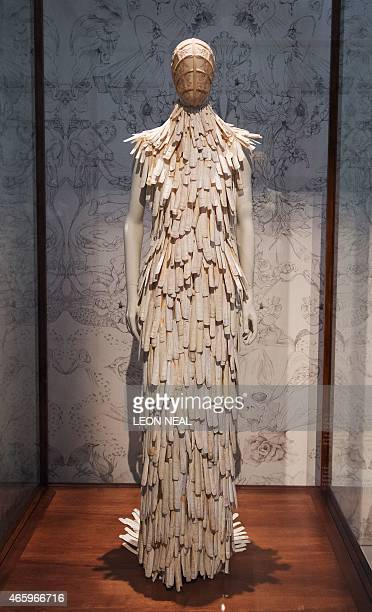 A razor clam shell encrusted dress from the 'Voss' Spring/Summer 2001 collection is on display during a press preview of Alexander McQueen's 'Savage...