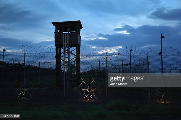 Razor wire and a guard tower stands at a closed section of the US prison at Guantanamo Bay also known as 'Gitmo' on October 22 2016 at the US Naval...
