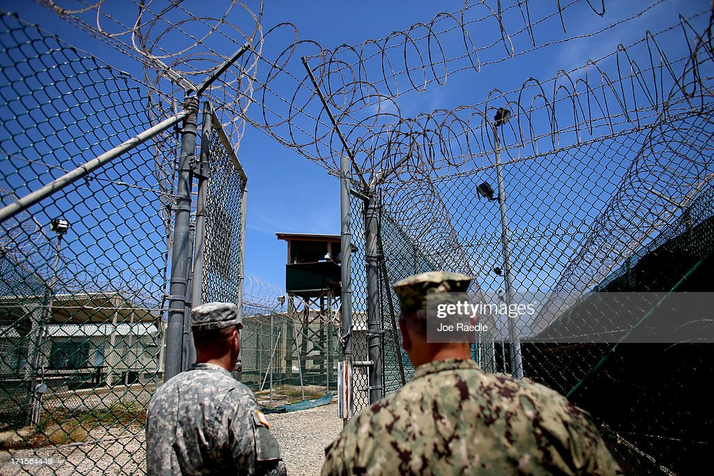 Razor wire is seen on the fence around Camp Delta which is part of the US military prison for 'enemy combatants' on June 26 2013 in Guantanamo Bay...