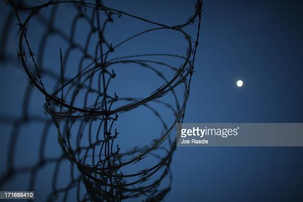 Razor wire is seen on the fence around the currently closed Camp XRay which was the first detention facility to hold 'enemy combatants' at the US...