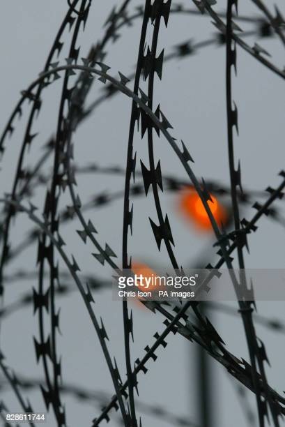 Razor wire on the perimeter fence of HMS Daedalus a former naval base in Gosport Hampshire Plans to convert the site into a new asylum accommodation...
