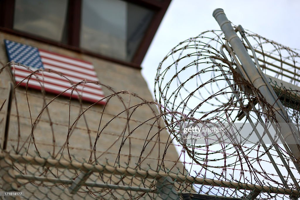 Razor wire tops a fence near the guard tower at the entrance to Camp V and VI at the US military prison for 'enemy combatants' on June 25 2013 in...