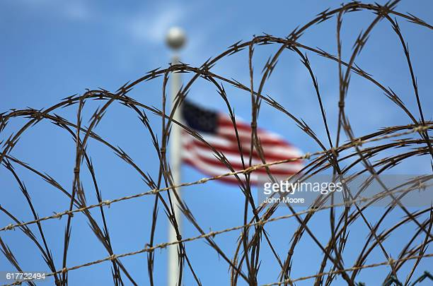 Razor wire tops the fence of the US prison at Guantanamo Bay also known as 'Gitmo' on October 23 2016 at the US Naval Station at Guantanamo Bay Cuba...