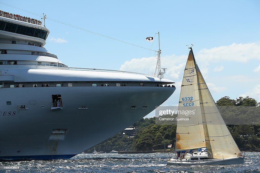 'Razors Edge' sails next to the Diamond Princess cruise ship during the Sydney Regatta on Sydney Harbour, on March 9, 2013 in Sydney, Australia.