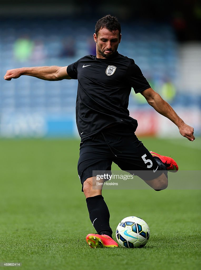 <a gi-track='captionPersonalityLinkClicked' href=/galleries/search?phrase=Razvan+Rat&family=editorial&specificpeople=2147212 ng-click='$event.stopPropagation()'>Razvan Rat</a> of PAOK in action during the Pre-Season Friendly match between Queens Park Rangers and PAOK FC at Loftus Road on August 9, 2014 in London, England.