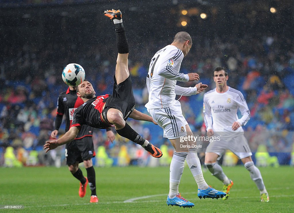 Razvan Rat (L) of Rayo Vallecano de Madrid takes the ball from Alvaro Morata of Real Madrid FC during the La Liga match between Real Madrid CF and Rayo Vallecano de Madrid at Santiago Bernabeu stadium on March 29, 2014 in Madrid, Spain.