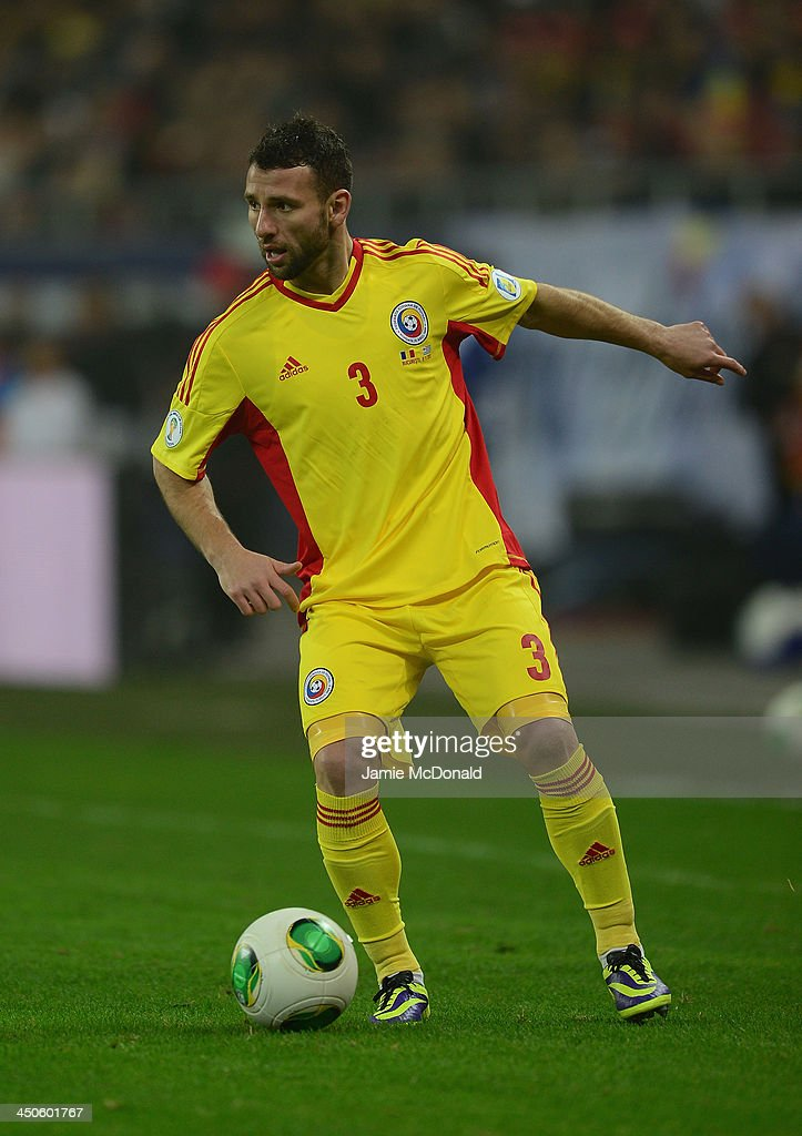 <a gi-track='captionPersonalityLinkClicked' href=/galleries/search?phrase=Razvan+Rat&family=editorial&specificpeople=2147212 ng-click='$event.stopPropagation()'>Razvan Rat</a> of Romania in action during the FIFA 2014 World Cup Qualifier Play-off Second Leg match between Romania and Greece at the National Arena on November 19, 2013 in Bucharest, Romania.