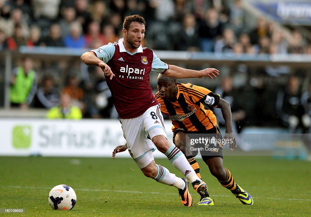 <a gi-track='captionPersonalityLinkClicked' href=/galleries/search?phrase=Razvan+Rat&family=editorial&specificpeople=2147212 ng-click='$event.stopPropagation()'>Razvan Rat</a> of West Ham controls the ball as Sone Aluko of Hull City closes in during the Barclays Premier League match between Hull City and West Ham United at KC Stadium on September 28, 2013 in Hull, England.