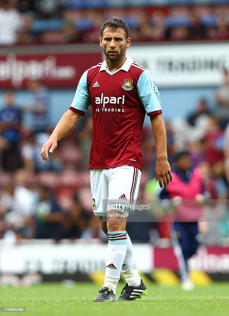 <a gi-track='captionPersonalityLinkClicked' href=/galleries/search?phrase=Razvan+Rat&family=editorial&specificpeople=2147212 ng-click='$event.stopPropagation()'>Razvan Rat</a> of West Ham looks on during the Pre Season Friendly match between West Ham United and Pacos de Ferreira at the Boleyn Ground on August 10, 2013 in London, England.