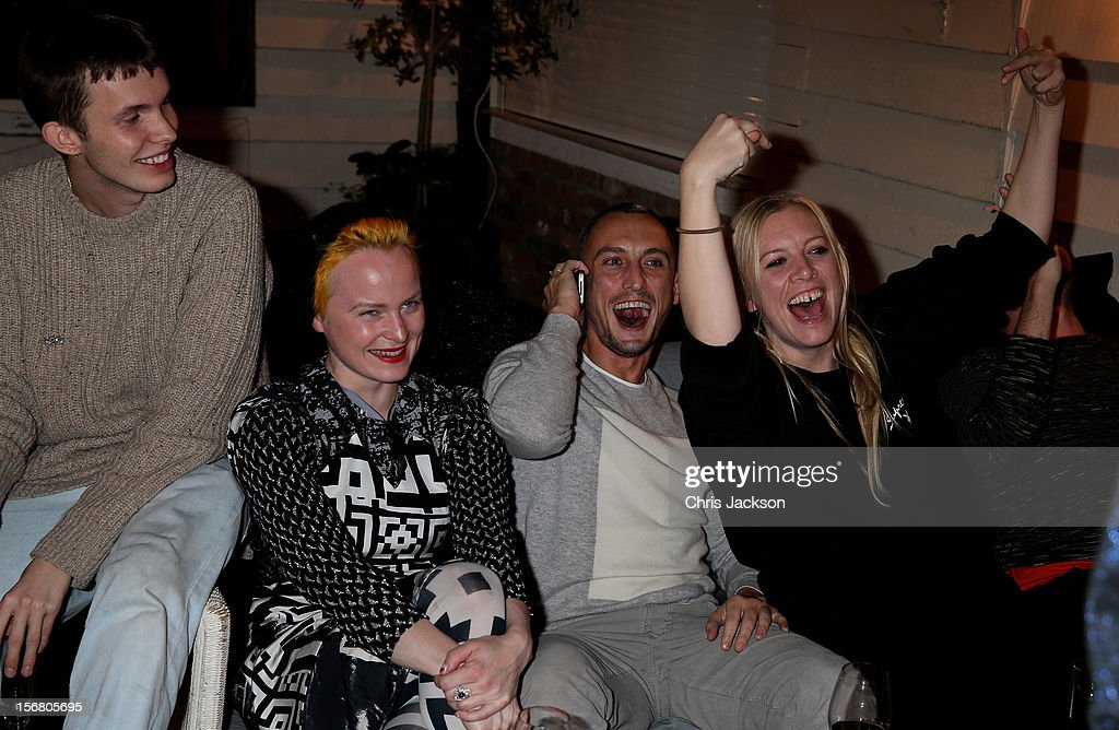 Rchard Nicoll (2nd R) and his team celebrate winning £100 for the Kids Company charity during the Vodafone Fashionable Pub Quiz at Shoreditch House on November 21, 2012 in London, United Kingdom. As Principal Sponsor of London Fashion Week, the quiz celebrated Vodafone's commitment to British Fashion.