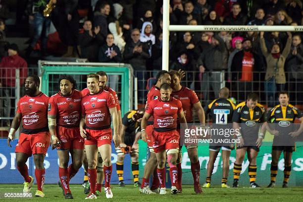 RCToulon's players celebrate after RC Toulon's Australian wing Drew Mitchell scoring a goal during the European Champions Cup rugby union match RC...