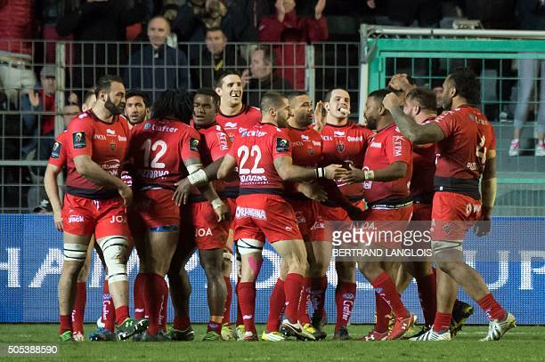 RCToulon's players celebrate after scoring a try during the European Champions Cup rugby union match RC Toulon vs Wasps on January 17 2016 at the...