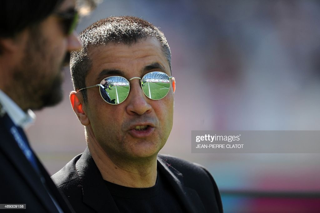 ]RCToulon's president <a gi-track='captionPersonalityLinkClicked' href=/galleries/search?phrase=Mourad+Boudjellal&family=editorial&specificpeople=3974182 ng-click='$event.stopPropagation()'>Mourad Boudjellal</a> (R) speak with Grenoble's president Marc Chereque before the French Top 14 rugby union match Grenoble (FCG) against Toulon (RCT) on April 11, 2015 at the Stade des Alpes in Grenoble. AFP PHOTO / Jean Pierre Clatot