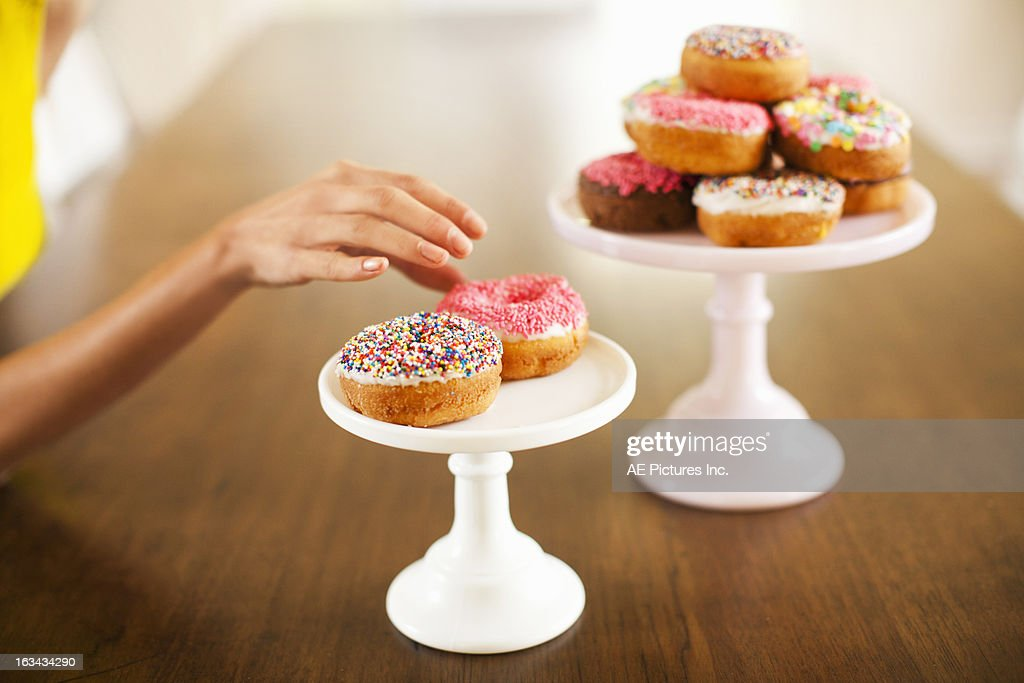 Reaching for a donut : Stock Photo