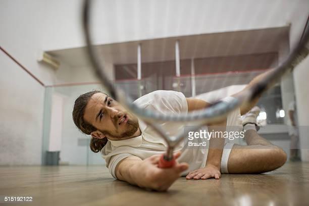 Reaching for the squash ball!
