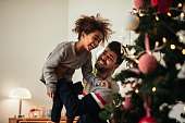 Shot of an african american father and daughter celebrating Christmas with love at home.