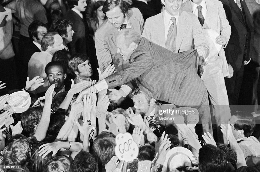 Reaching out to his cheering supporters President Ford is prevented from falling into the crowd by son Jack Crowd turned out to greet Ford upon his...