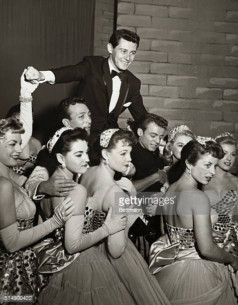 Reacting to a standing ovation for Eddie Fisher following his Las Vegas debut at the formal opening of the new $15000 Tropicana on Thursday night...